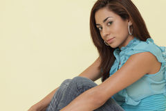 Attractive woman in a sitting pose Stock Images