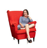 Attractive woman sitting on red chair Royalty Free Stock Photo