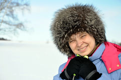 Attractive woman with ski over winter background Royalty Free Stock Photos