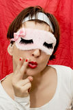 Attractive woman with sleep mask simulates smoking Royalty Free Stock Images