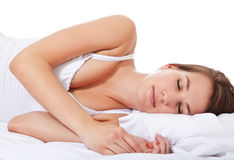 Attractive woman sleeping bed Stock Photos