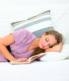 Attractive woman sleeping on sofa at living room Stock Image