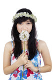 Attractive woman smelling a spring flower Stock Photos