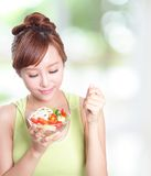Attractive woman smile eating salad Royalty Free Stock Images