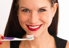 Attractive Woman Smiles Adult Female Brushing Teeth Toothbrush. Pretty woman holding toothbrushbefore brushing her teeth Stock Photography