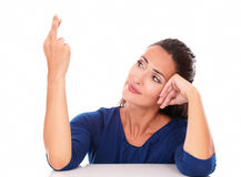 Attractive woman smiling and crossing fingers Royalty Free Stock Photography