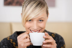 Attractive woman smiling with a cup of coffee Royalty Free Stock Photo