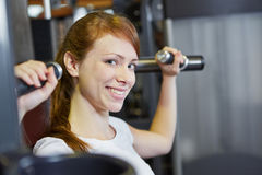 Attractive woman smiling in fitness Stock Image