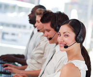 Attractive woman smiling with a headset on Royalty Free Stock Images