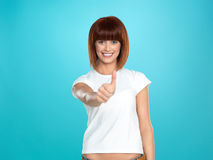 Attractive woman smiling with her thumb up Royalty Free Stock Photo