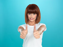 Attractive woman smiling with her thumbs up Stock Photos