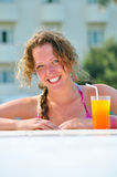 Attractive woman is smiling from pool Royalty Free Stock Photo