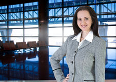 Attractive  woman smiling portrait in airport Royalty Free Stock Photography