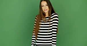 Attractive woman smiling and posing in a striped shirt. stock video footage