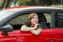 Free Attractive Woman Smiling Proud Sitting At Driver Seat Holding And Showing Car Key In New Automobile Buying And Renting Royalty Free Stock Photography - 101092607