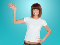 Attractive woman smiling and waving Stock Images