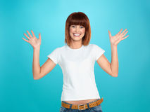 Attractive woman smiling and waving Royalty Free Stock Photography