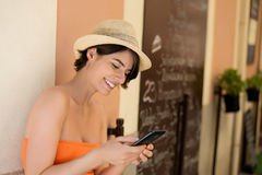 Attractive woman smiling while writing a message Royalty Free Stock Photo