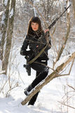 Attractive woman with a sniper rifle. Attractive young woman with a sniper rifle in winter forest Stock Photography
