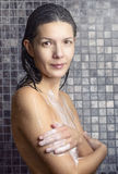 Attractive woman soaping herself in the shower Royalty Free Stock Photography