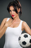 Attractive woman with soccer ball Royalty Free Stock Photography
