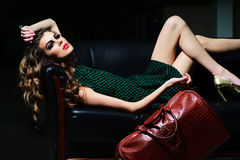 Attractive woman on sofa Royalty Free Stock Images
