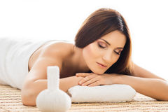 Attractive woman in spa having massage Stock Photos