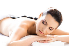Attractive woman in spa having massage Stock Images