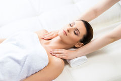 Attractive woman in spa having massage Royalty Free Stock Photography