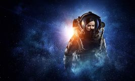 Attractive woman in spacesuit stock photo