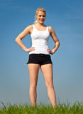 Attractive woman in sports wear outside Stock Images