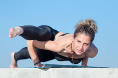 Attractive woman in sportswear doing yoga on open air Royalty Free Stock Photos