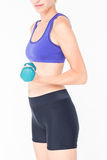 Attractive woman in sportswear lifting dumbbell Royalty Free Stock Image