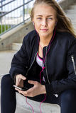 Attractive Woman In Sportswear Listening Music On Smartphone Royalty Free Stock Photo