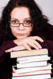 Attractive woman with stack of books Stock Image
