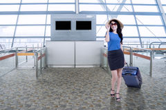 Attractive woman standing in airport Royalty Free Stock Photos