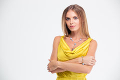 Attractive woman standing with arms folded Royalty Free Stock Photo