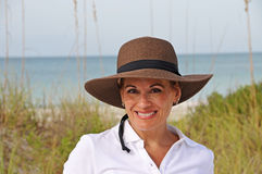 Attractive Woman Standing on the Beach Royalty Free Stock Image
