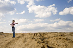Attractive woman standing in the desert Royalty Free Stock Image