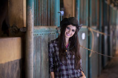 Attractive woman standing at horse ranch Royalty Free Stock Photo