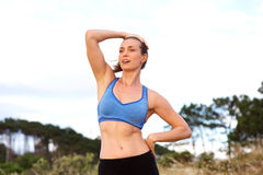 Attractive woman standing outside resting after run Royalty Free Stock Images