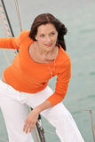 Attractive woman standing on sailing boat Stock Photography