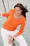 Attractive woman standing on sailing boat Royalty Free Stock Image