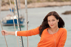 Attractive woman standing on sailing boat Stock Images