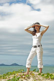 Attractive woman standing on sand dune Royalty Free Stock Photo