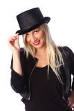 Attractive woman standing in tophat Stock Photography