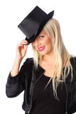 Attractive woman standing in tophat Stock Images