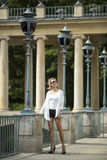 Attractive  woman standing in a Warsaw Park. Royalty Free Stock Photos