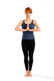 Attractive Woman Standing in Yoga Pose Royalty Free Stock Photography