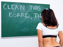 Attractive woman stands in front of chalkboard Stock Photo